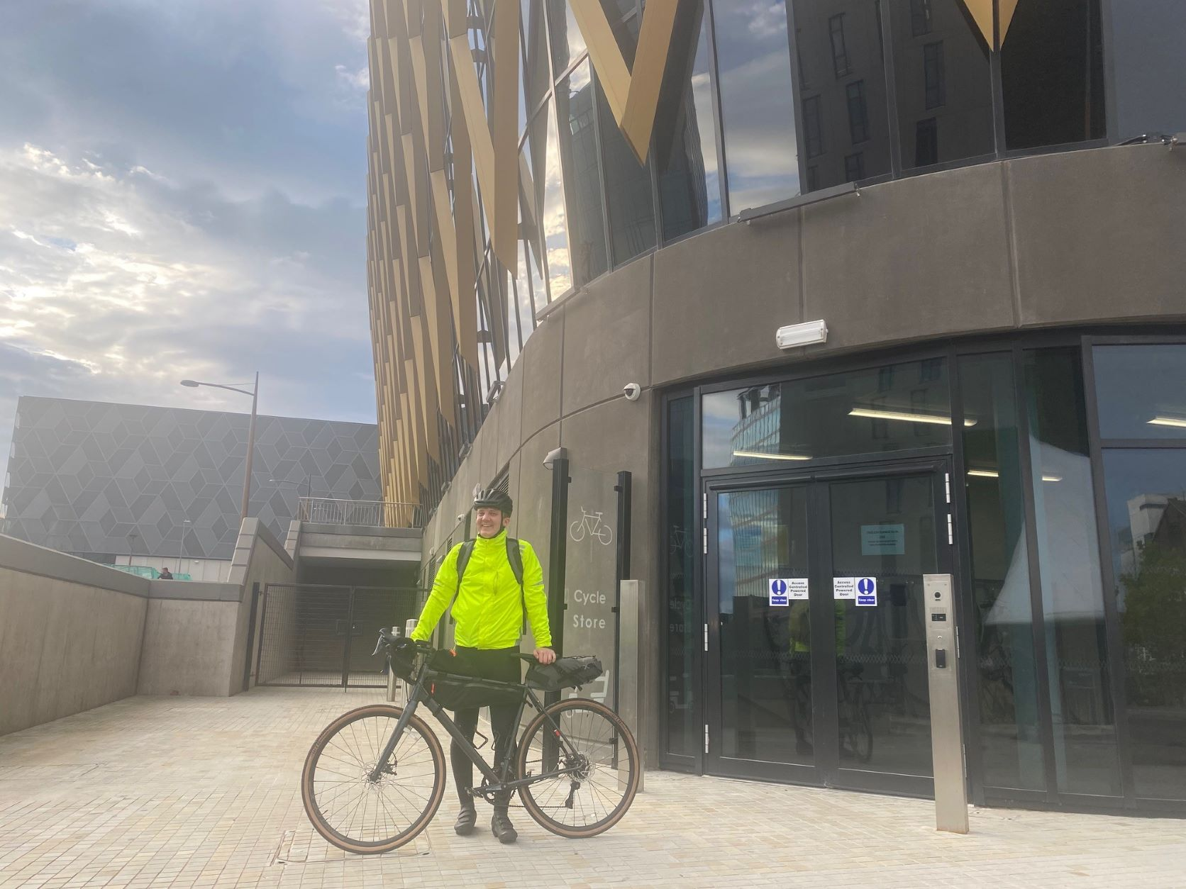 Man with bike outside of The Catalyst